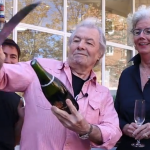 Jacques Pepin opens a bottle of champagne