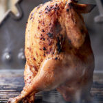 Hickory-Smoked Beer Can Chicken from WEBER'S GREATEST HITS by Ray Kachatorian. Copyright © 2017 by Ray Kachatorian. Used by permission of Houghton Mifflin Harcourt. All rights reserved