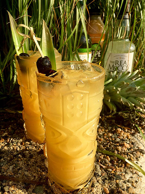 The Faith In Tiki cocktail named in honor of NPR's Faith Middleton for National Rum Day 2017. Recipe: 1.5 oz The Real McCoy 3 Year Aged • .25 oz Taylor Velvet Falernum • 2.5 oz Ripe Bajan Punch • hint Tiki Bitters • The Real McCoy 12 Year float • Luxardo Cherries + Pineapple Leaf Garnish.