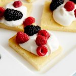 Lemon Ricotta Cake with Sweetened Whipped Cream and Berries